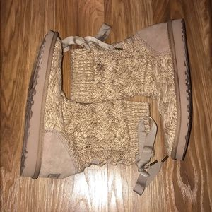 Brand new UGG boots with bow tie on back. Knit